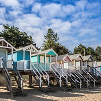 Buy canvas prints of Colourful Beach Huts at Wells Next The Sea, Norfol by David Woodcock