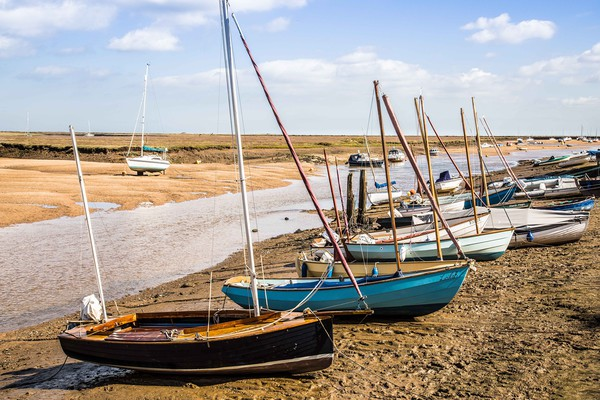 Wells Next The Sea, Boats in the Harbour Canvas print by David Woodcock