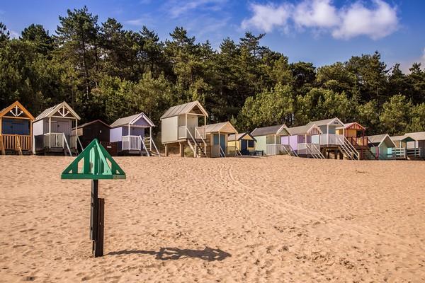 Wells Next The Sea, Beach Huts   Canvas print by David Woodcock