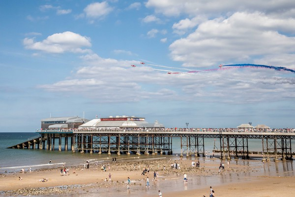 Red Arrows, Cromer  Canvas print by David Woodcock