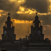 Buy canvas prints of Orange sunset over the Liver Building by Paul Madden