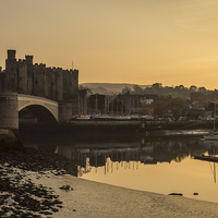 Buy canvas prints of Conwy Castle and harbour by Paul Madden