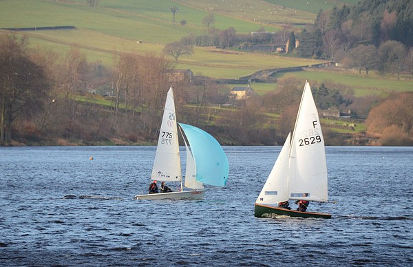 Dinghy Racing In Winter Canvas Print by Malcolm Snook