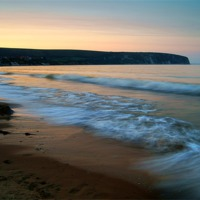 Buy canvas prints of Sunset over Swanage Bay, Dorset by Darren  Galpin
