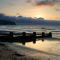 Buy canvas prints of Sunrise over Swanage Bay, Dorset by Darren  Galpin