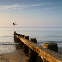 Buy canvas prints of High Tide Marker & Groynes, Swanage Bay by Darren  Galpin