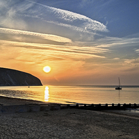 Buy canvas prints of Swanage Bay Sunrise by Darren  Galpin