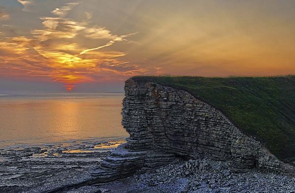 Nash Point Sunset  Canvas print by Darren  Galpin