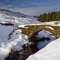 Buy canvas prints of Burbage Valley Packhorse Bridge  by Darren Galpin
