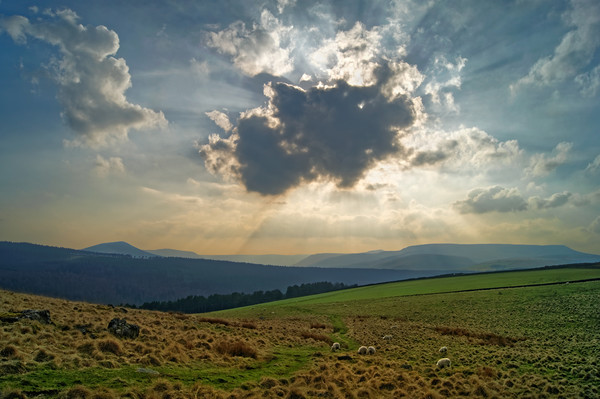 Crespuscular Rays from Crook Hill Canvas print by Darren Galpin