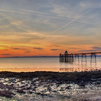 Buy canvas prints of  Clevedon Pier Beach At Sunset by austin APPLEBY