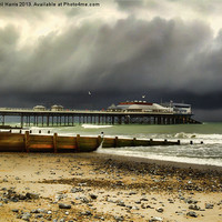 Buy canvas prints of Cromer Pier Storm by Avril Harris
